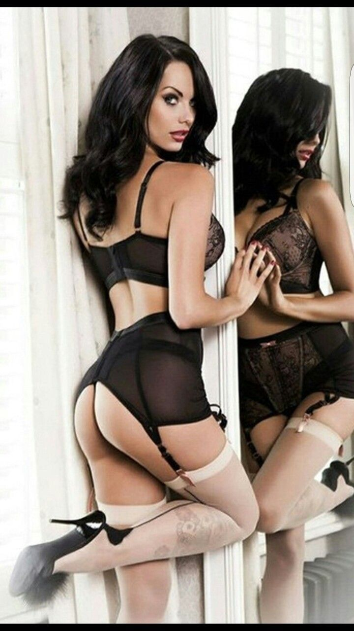 Sexy Brunette In Black Lingerie Posing In Front Of A Mirror