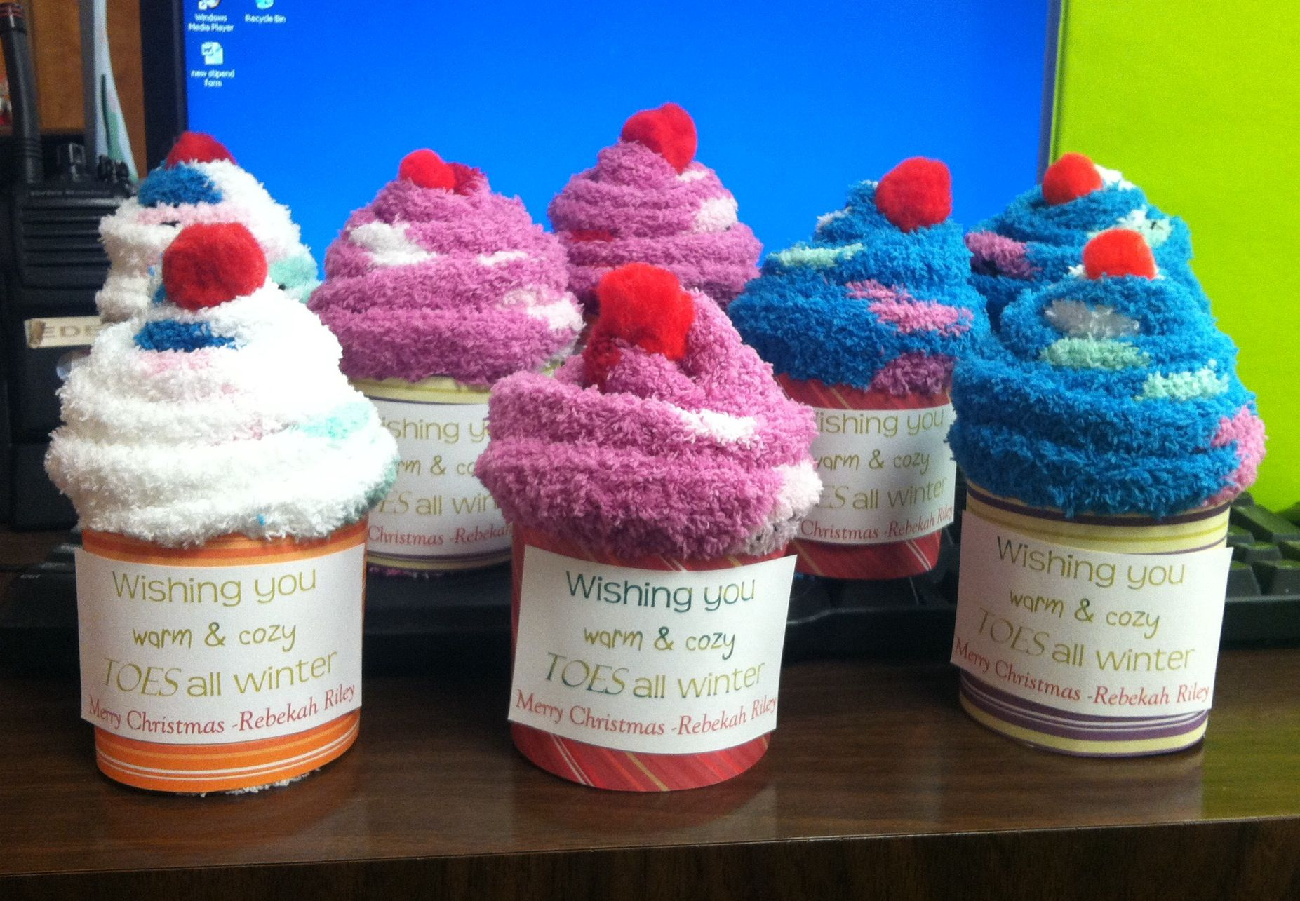 Wishing you warm and fuzzy mistle-toes this Christmas :-) They are fuzzy  socks rolled up to look like cupcakes that I made as fun Christmas gifts.