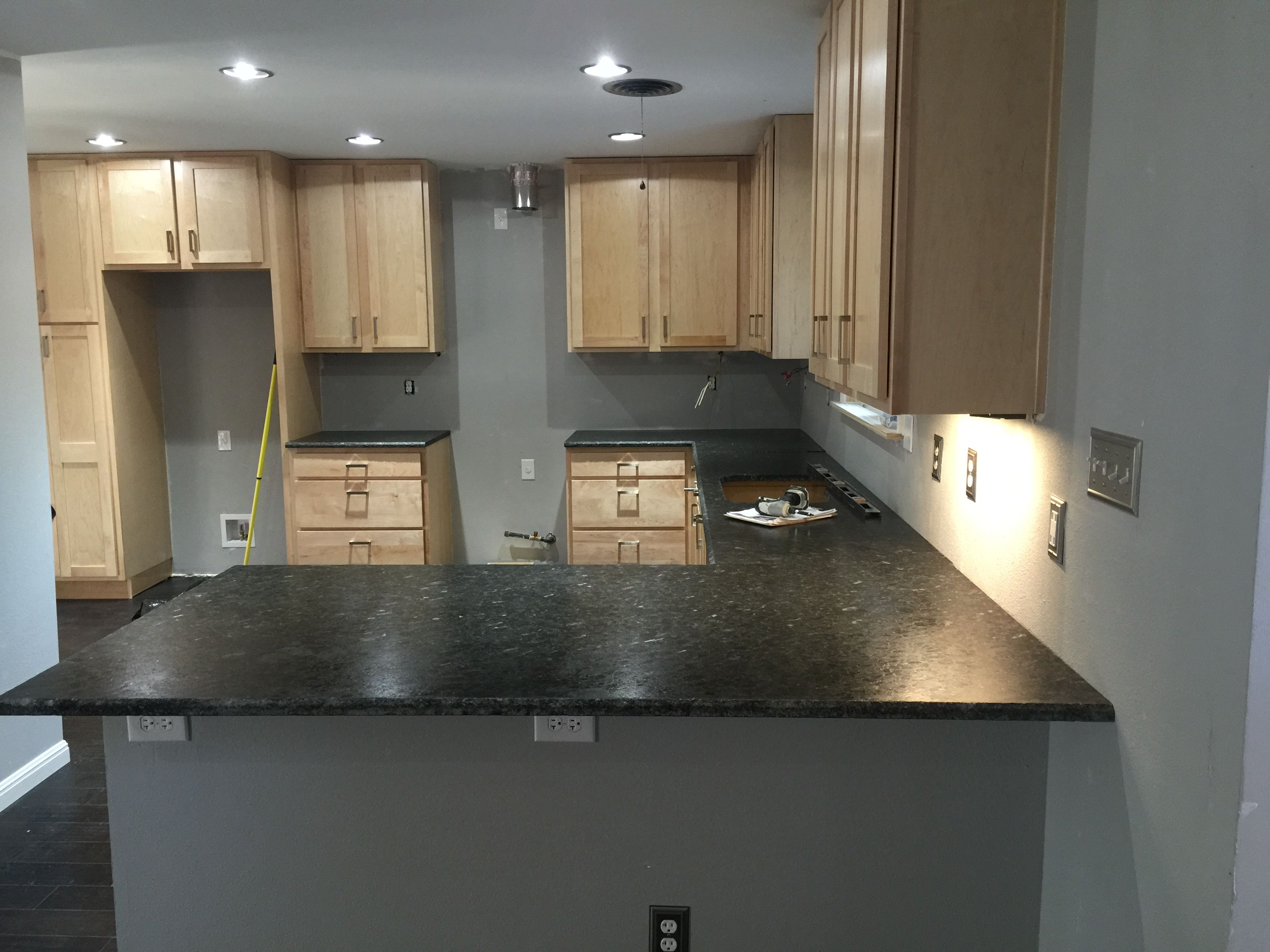 Countertops installed. Uba Tuba granite with a leather finish ...