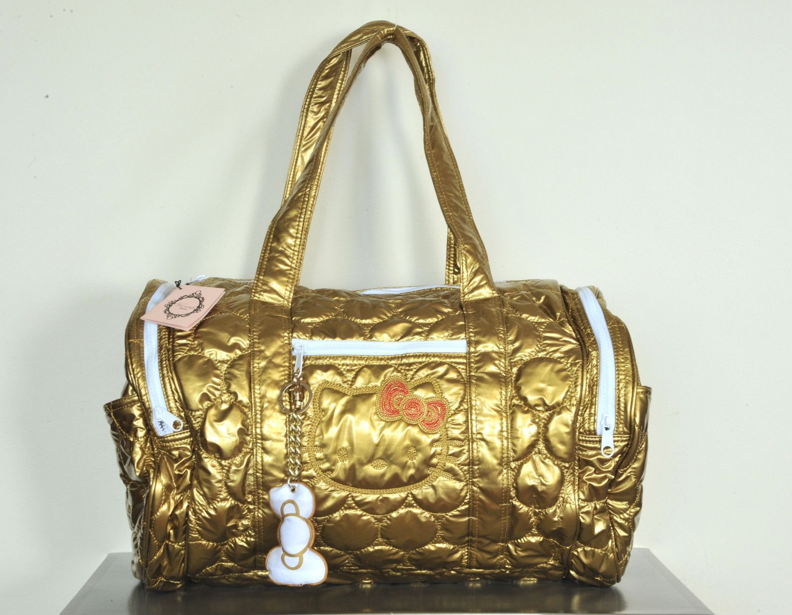 HELLO KITTY SANRIO VICTORIA COUTURE LARGE GOLD DUFFLE CARRY ON LUGGAGE NEW  NWT 26ecab5daa