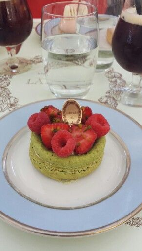 Pistachio macaroon with pistachio cream, raspberries and strawberries at Laduree, Paris.