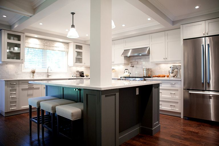 In this split the ceilings were coffered and recessed lighting was added A support post remains but helps frame the kitchen This island must be amazing for entertaining a...