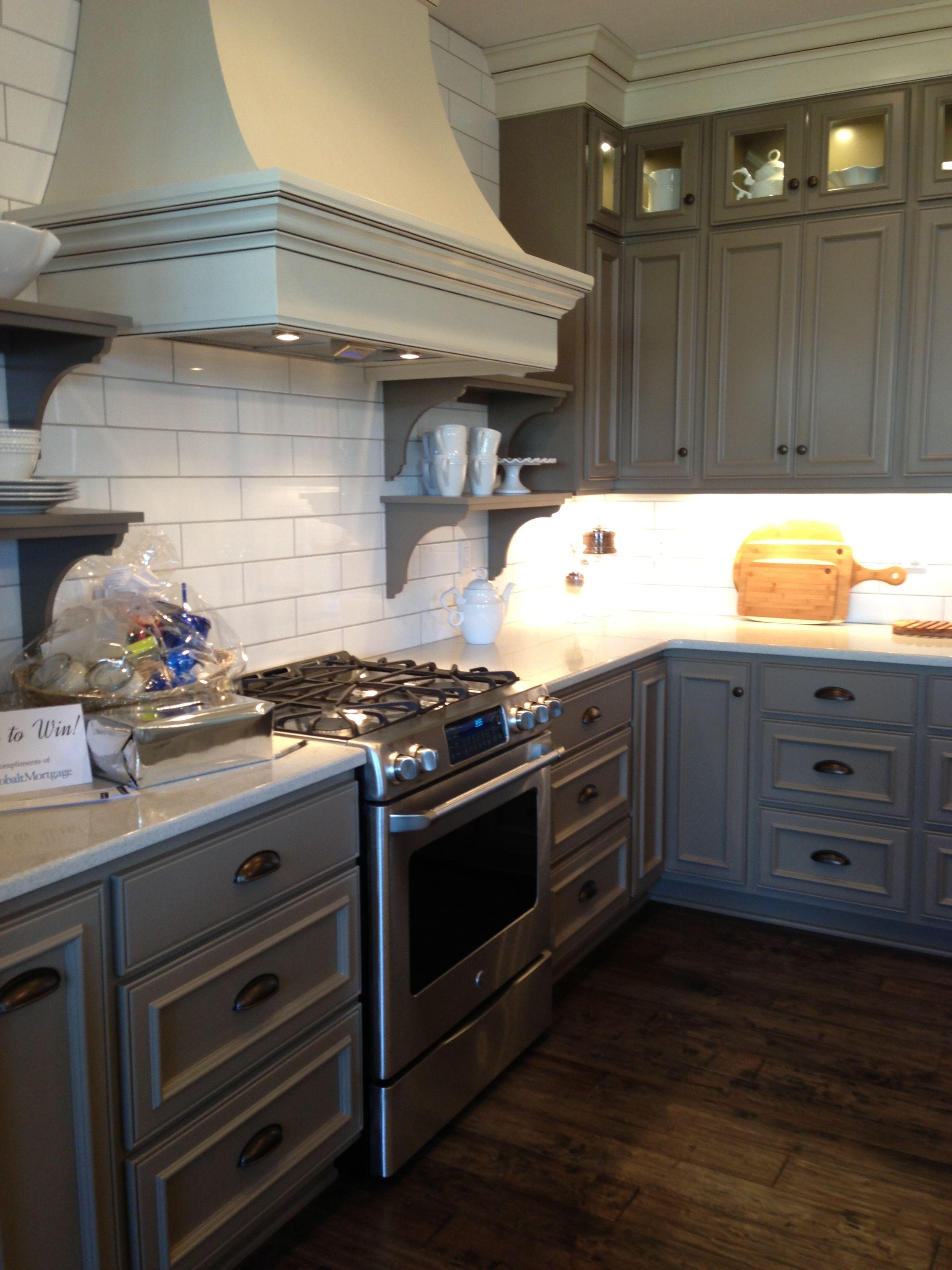 Interesting grey cabinets and white subway tile backsplash