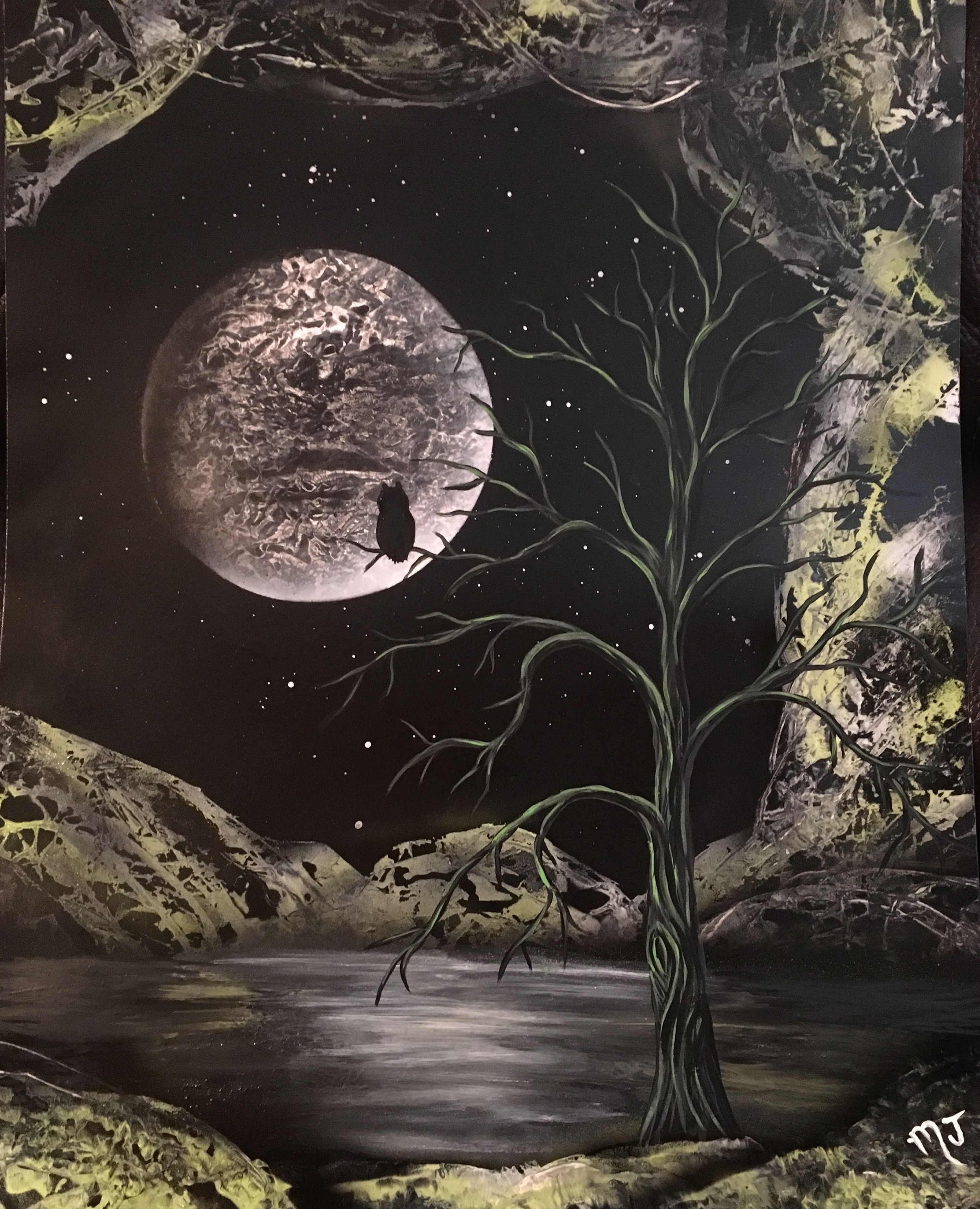 16x20 poster board with a spray paint background tree was painted