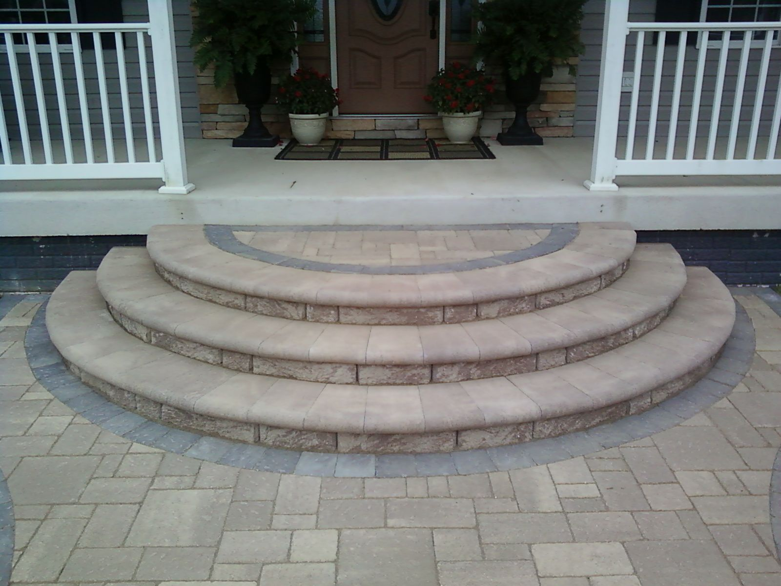 Concrete porch steps design the age old debate paver for Brick steps design ideas