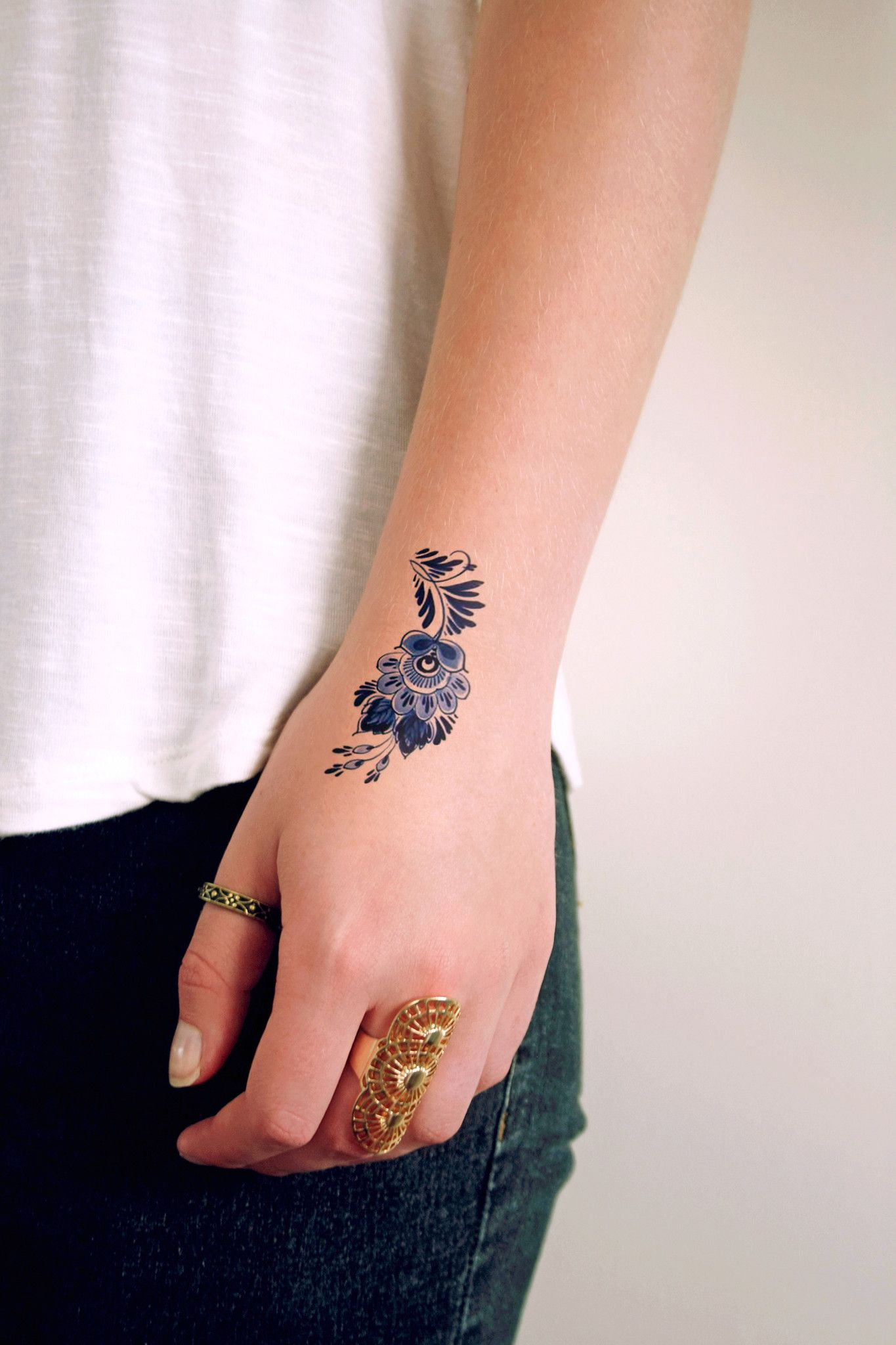 Small Delft Blue floral tattoo Blue flower tattoos, Hand