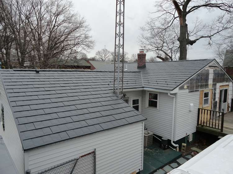 Metal Roofing Pros And Cons Cool Flat Roof Blog With Images Best Solar Panels Metal Shingle Roof Solar Roof Shingles