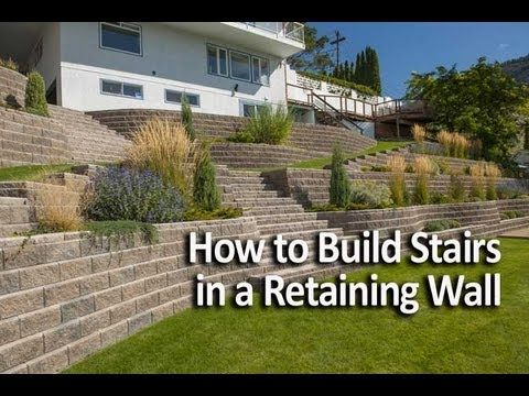 how to build a retaining wall on a slope video