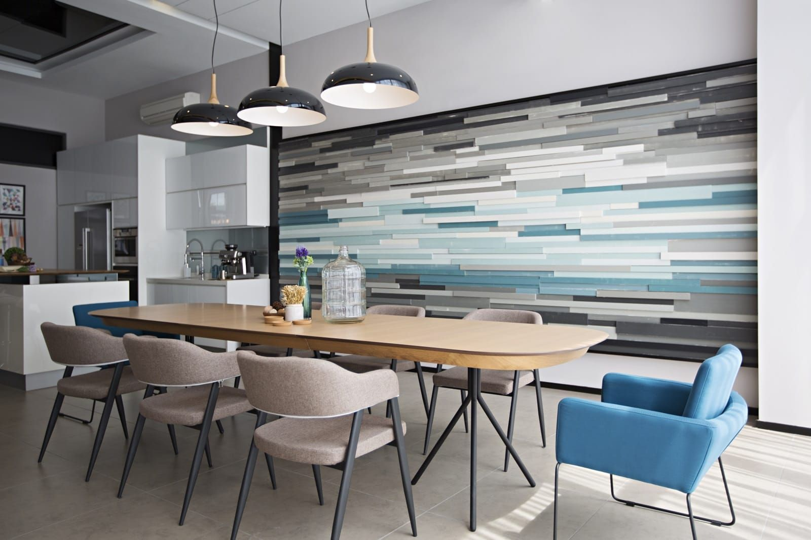 Unique Textured Feature Wall Adds A Soothing Design Element To The Dining Area