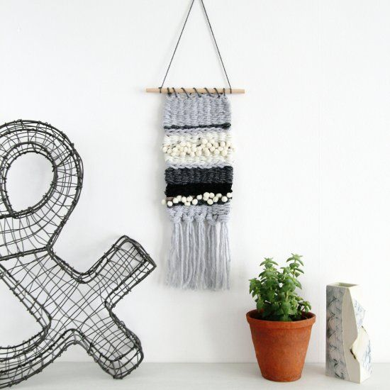 Learn how to make this adorable mini weaving. No loom needed.