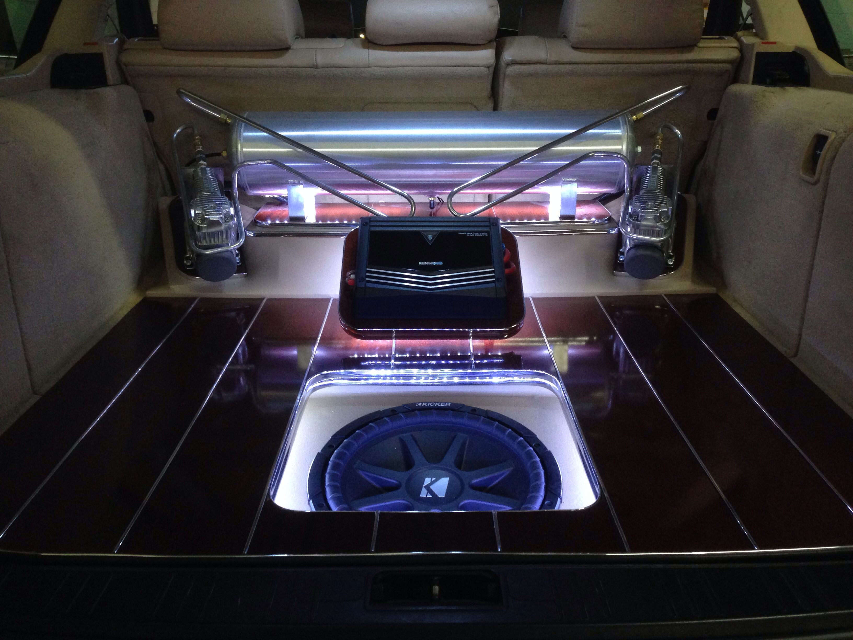 Custom airride setup with custom wood flooring and sound