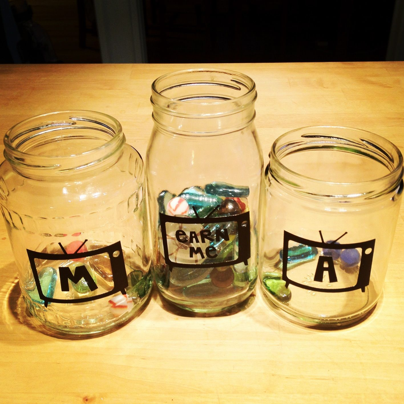 Screen time jars. Earn a marble and move it to your jar. One marble = 30 minutes of screen time!
