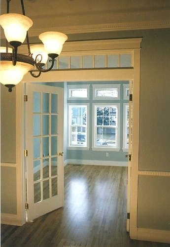 Craftsman Style Homes | Arts & Crafts Homes - doors from entry way to living room? #craftsmanstylehomes