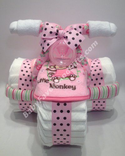 Pink for girl tricycle diaper cake http://babyfavorsandgifts.com/diaper-cakes-baby-girl-c-3_22.html