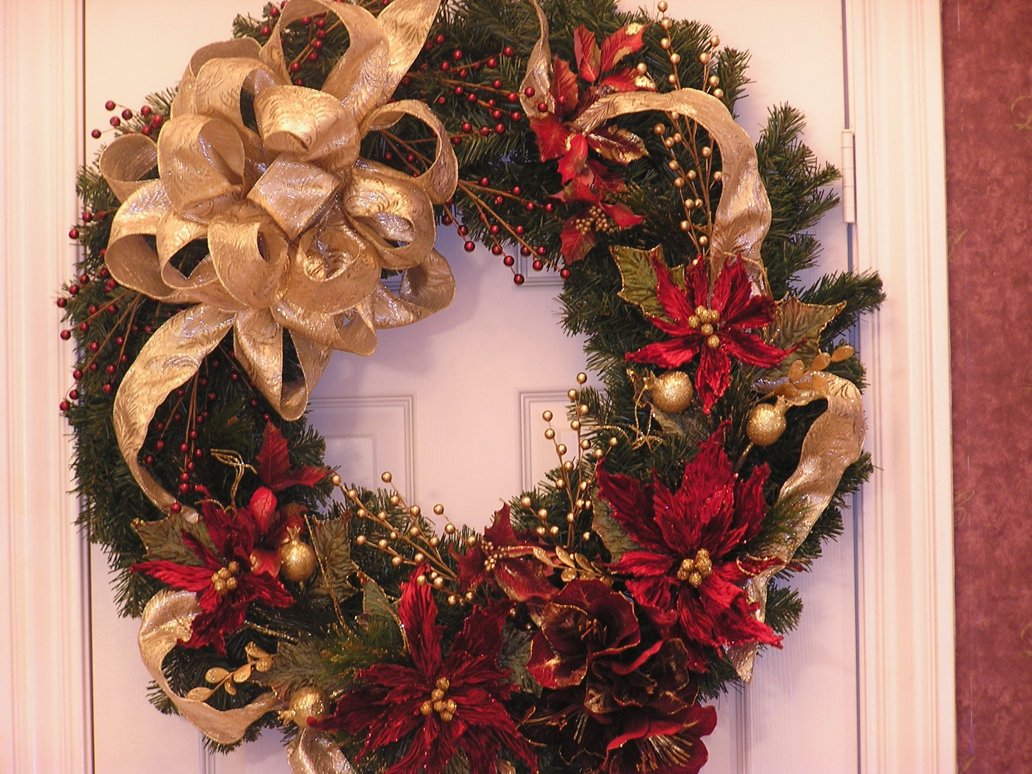 A poinsettia and pine cone wreath would look wonderfully