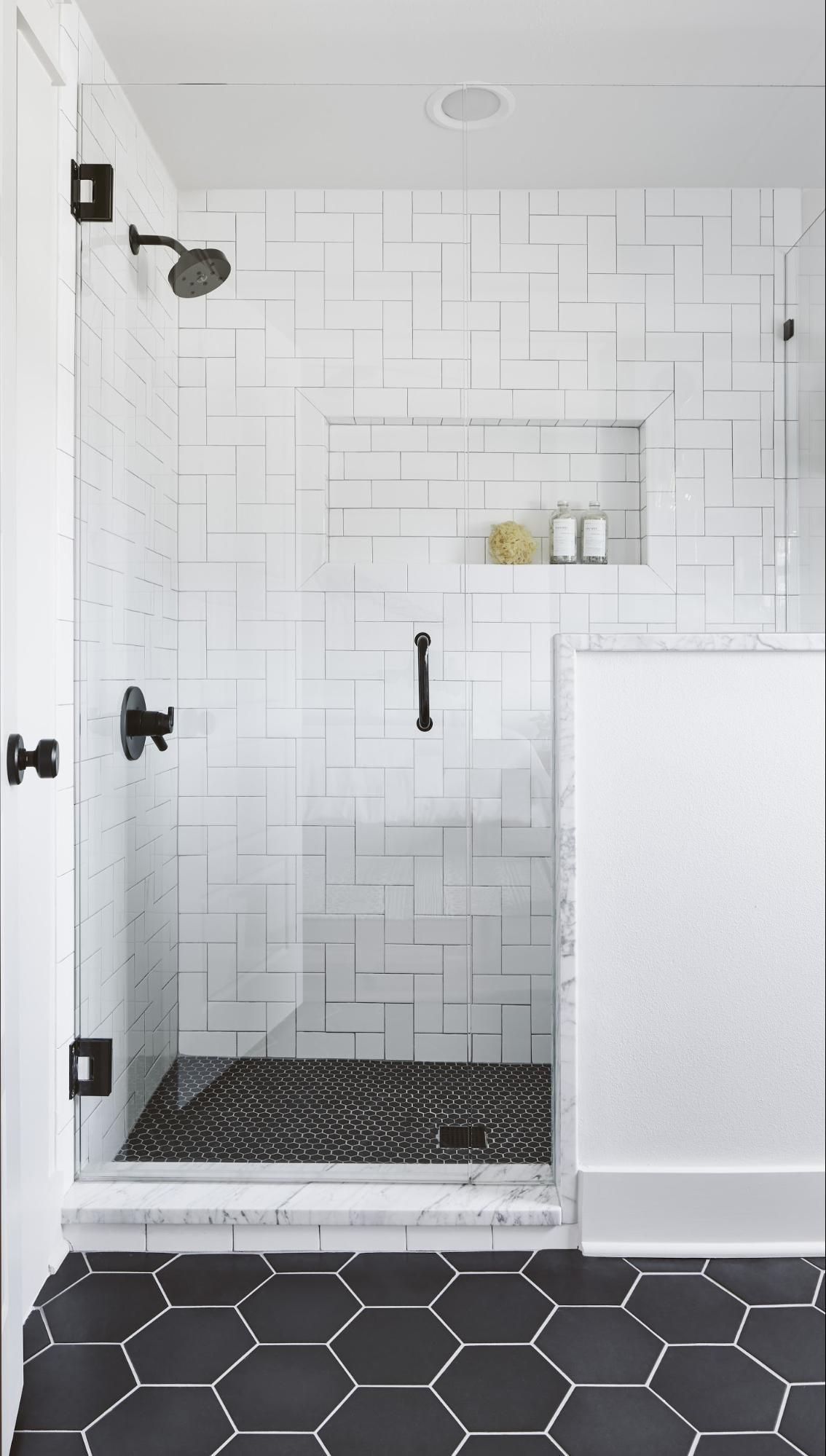The Hexagon Floor Tile And The Subway Tile Laid In A Basketweave Pattern Made This Room Feel Unique A Bathroom Shower Tile Bathroom Remodel Master Tile Remodel