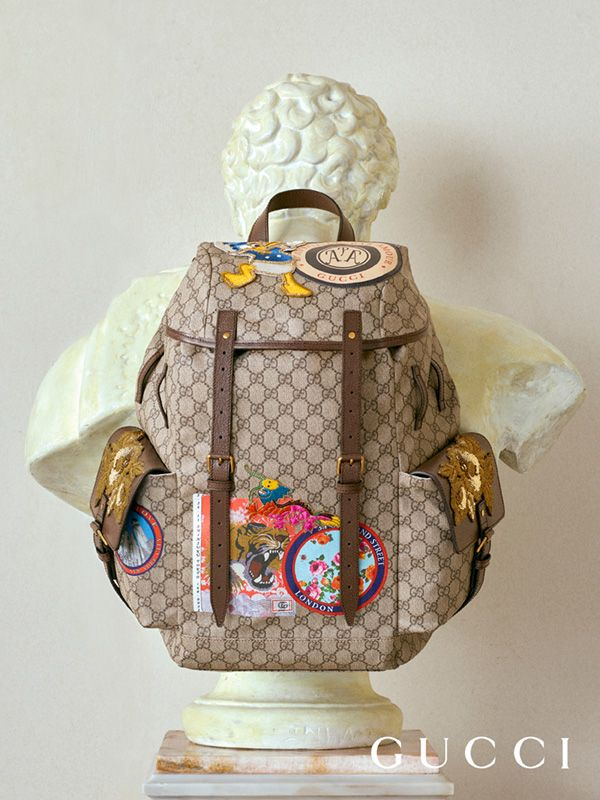 Introducing the Gucci Spring Summer 2017 backpack embellished with printed appliqués recalling travel stickers on vintage suitcases, colorful embroideries and House Web striped straps.