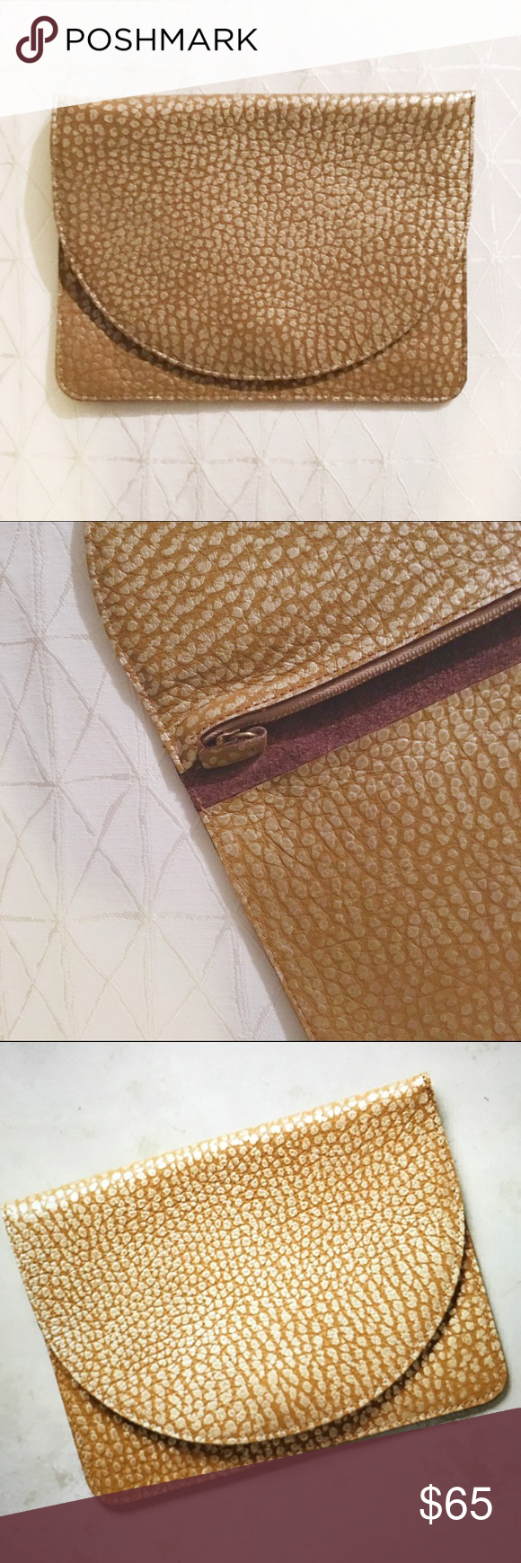 Anthropologie Fold Over Clutch Luna Half Moon 🌙 Fold Over clutch bought from Anthropologie. Beautiful brown leather with gold detail. Love this so much, but don't wear clutches a ton. Used once, so it is in excellent condition! Has one zipper pocket.  Minor History is the brand. Anthropologie Bags Clutches & Wristlets