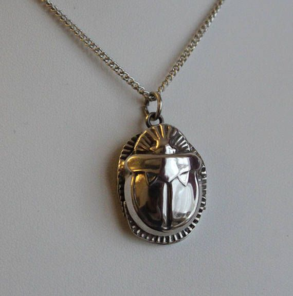 Vintage egyptian silver scarab pendant with silver chain vintage egyptian silver scarab beetle pendant with silver chain the scarab beetle was an ancient aloadofball Gallery