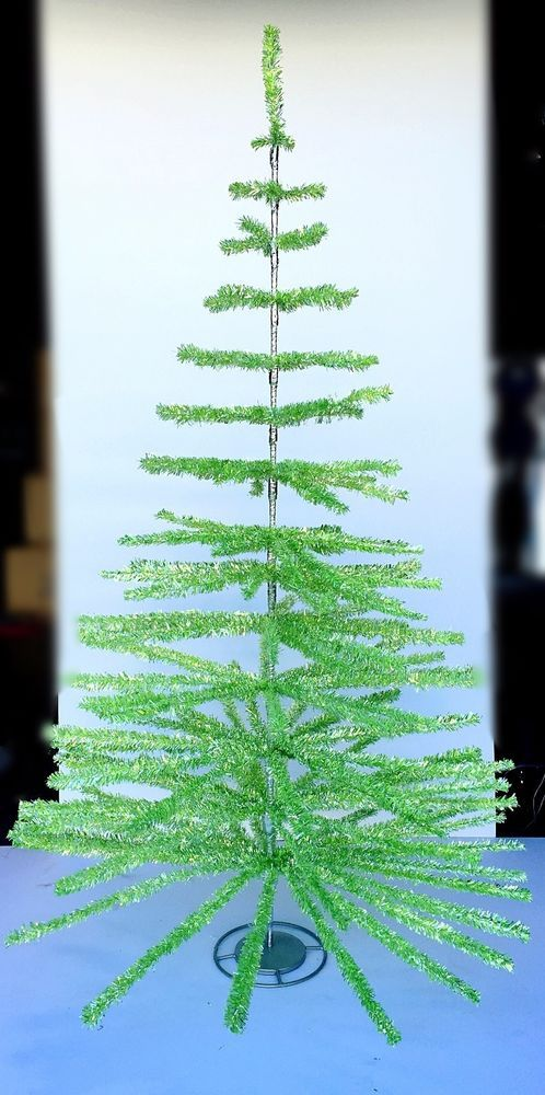 This is a new 6' GREEN/SILVER feather tinsel tree made in the traditional feather style with rows of branches and space between the rows. Made of flame resistant PVC Mylar tinsel wrapped onto a stiff wire. | eBay!