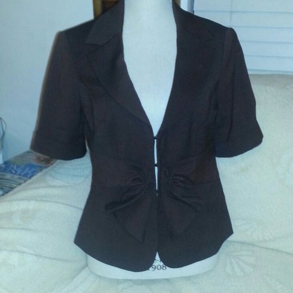 Dressy Blazer No flaws. Great to wear with a dress for the holidays. Is kinda of brown color. The Limited Jackets & Coats Blazers