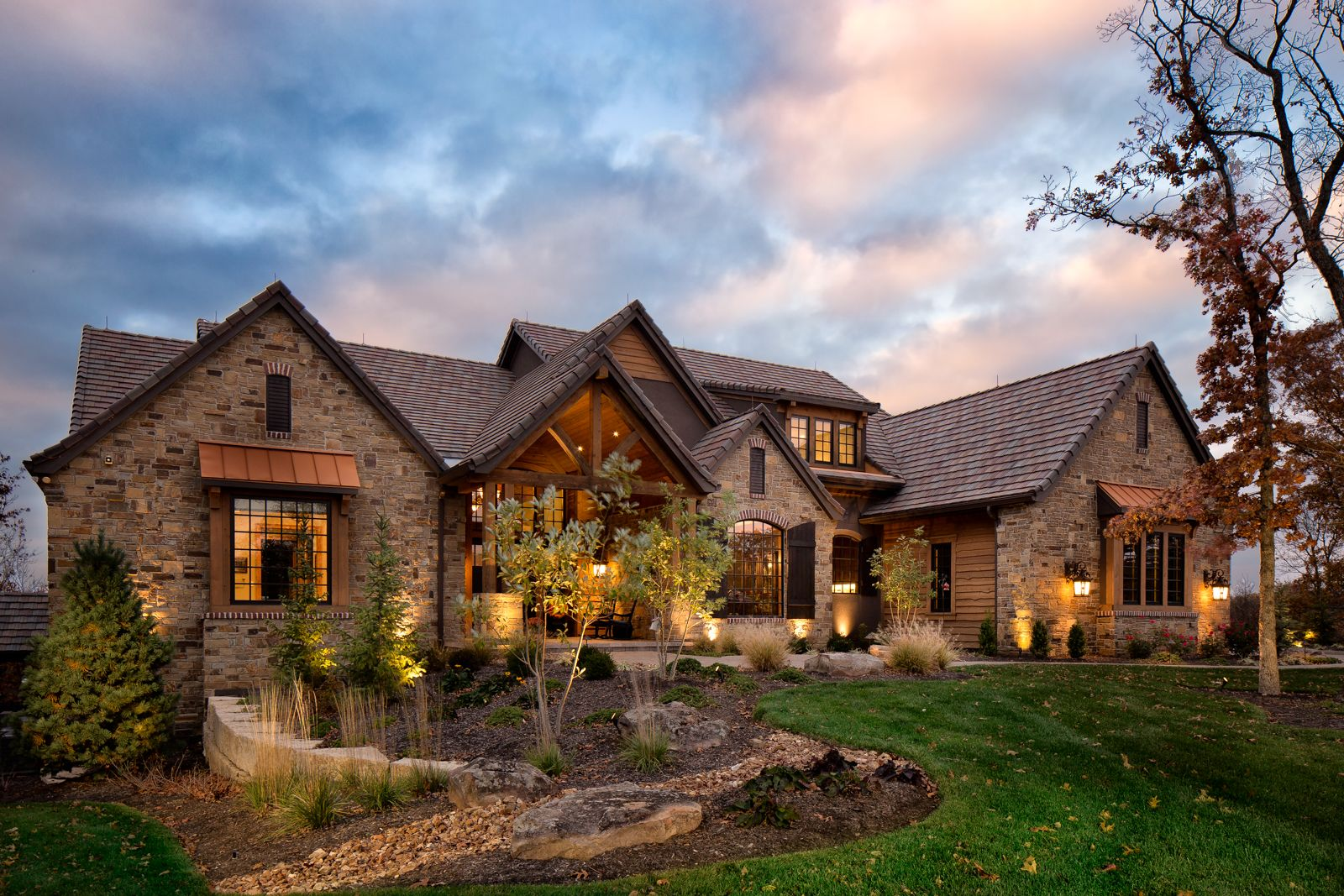 Country estate custom home front elevation at night for Custom estate home plans