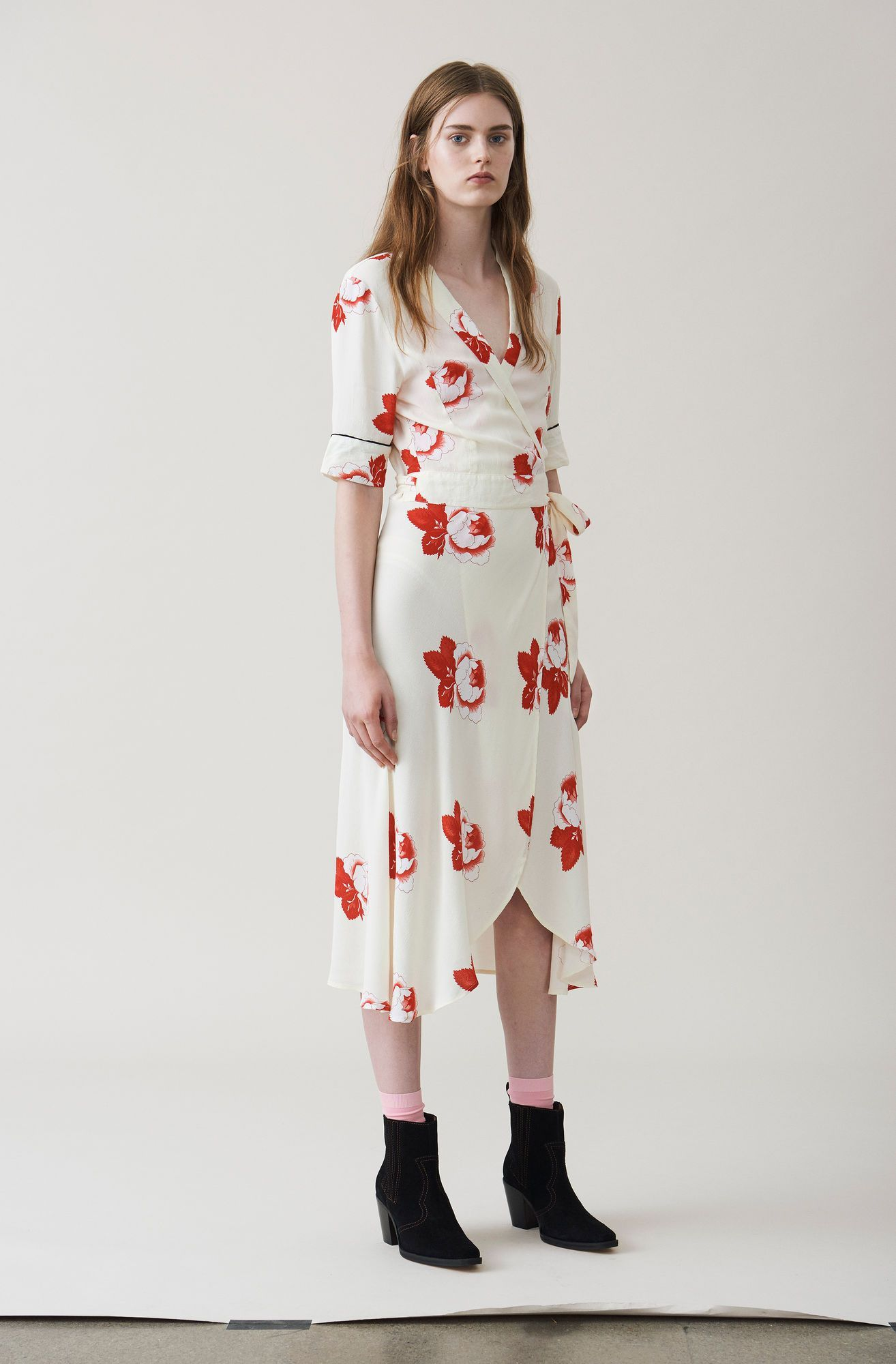 994d3e1fe66 Flattering wrap dress with a tea dress cut and roomy t-shirt sleeves  finished with a concealed waist belt and delicate frill details.