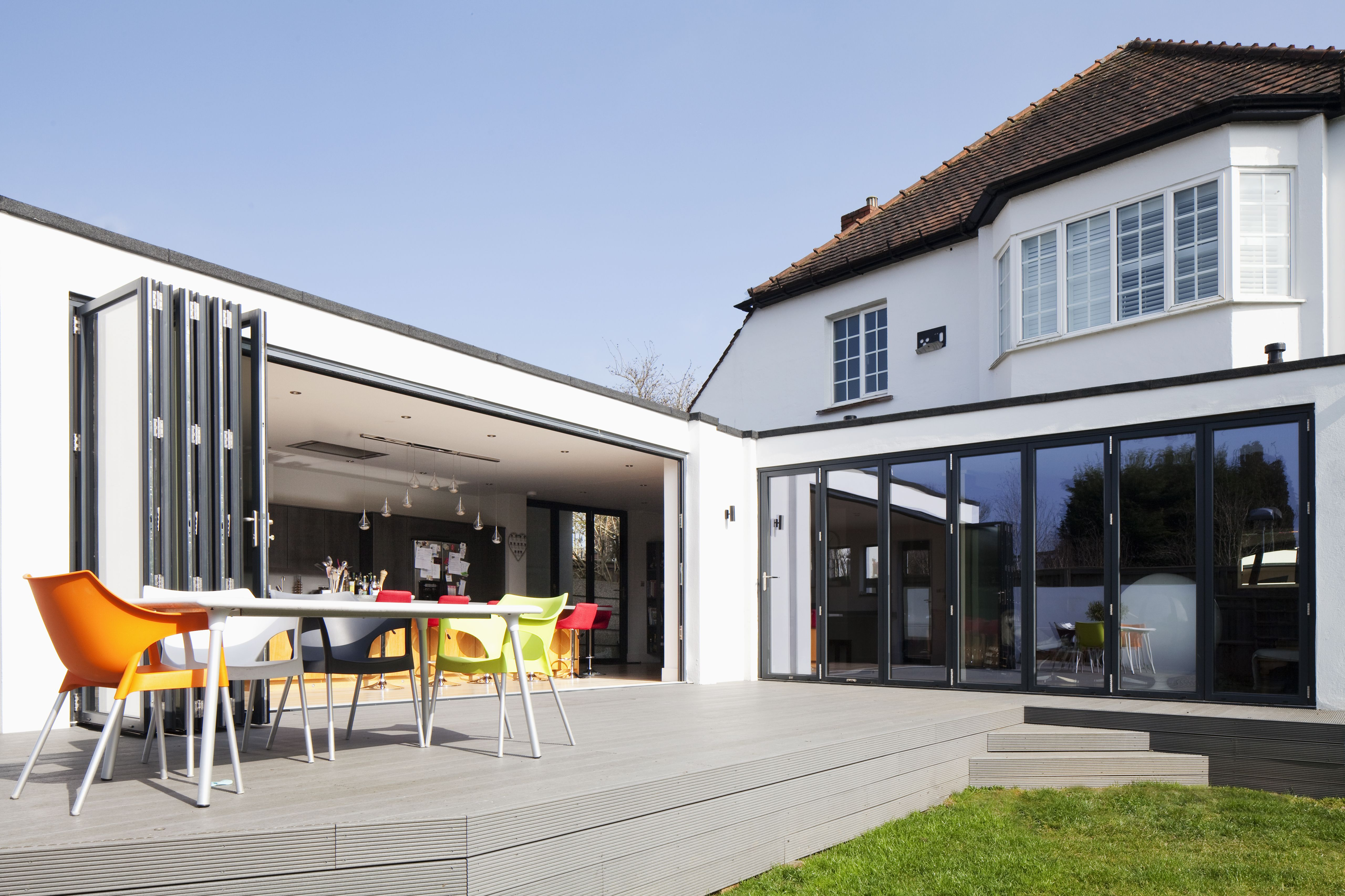 Contemporary Flat Roof Extension To Traditional House | White Render |  Aluminium Bi Fold Doors