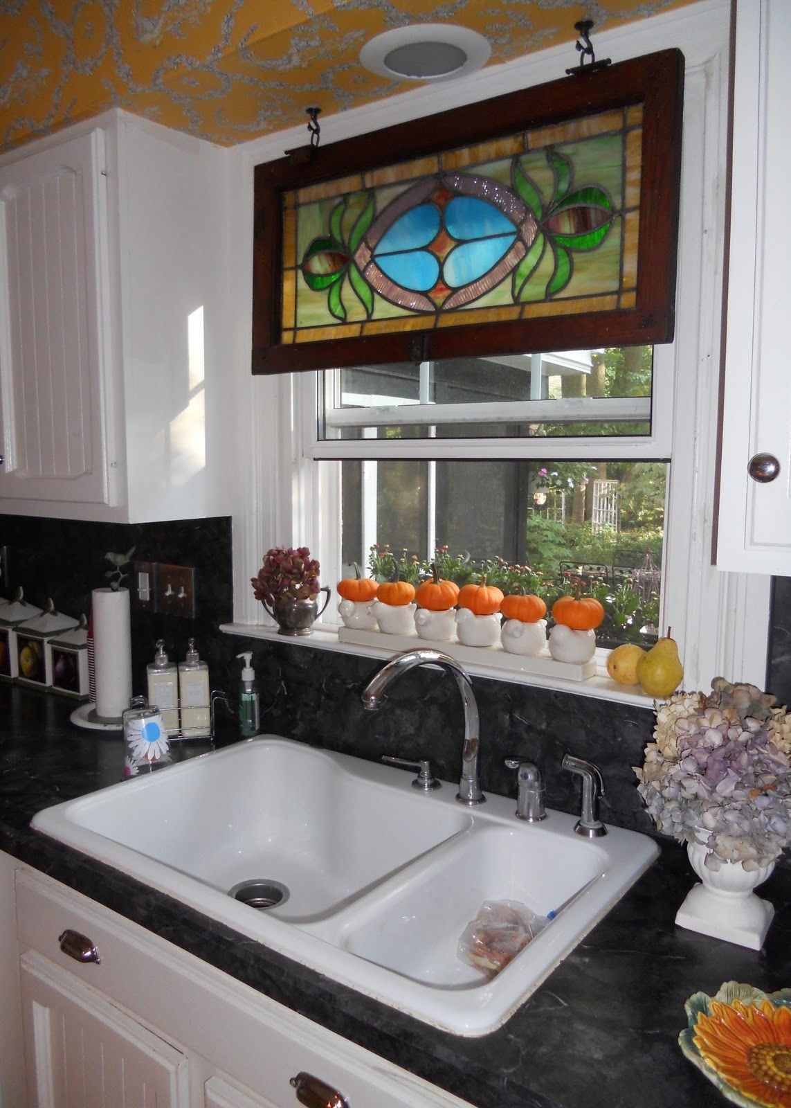 Kitchen sink window decor  tend to be seeing more stained glass panels on the upper level of