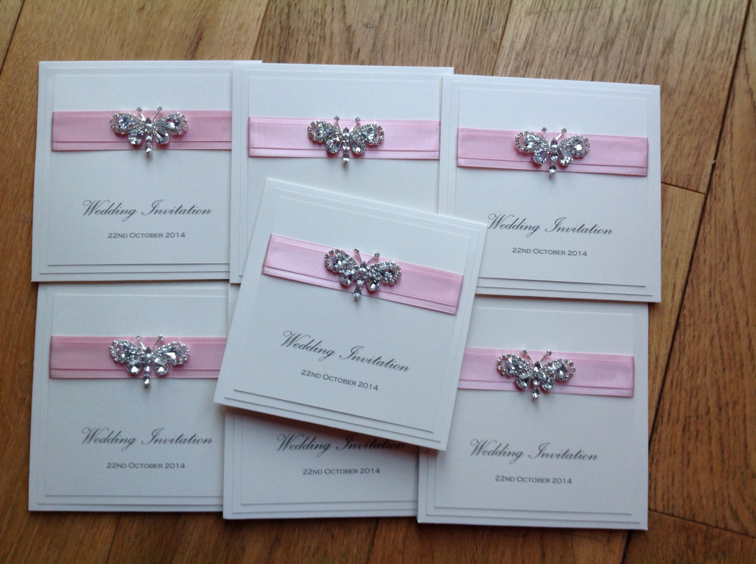 Pink butterfly wedding invitation with a crystal diamante ...