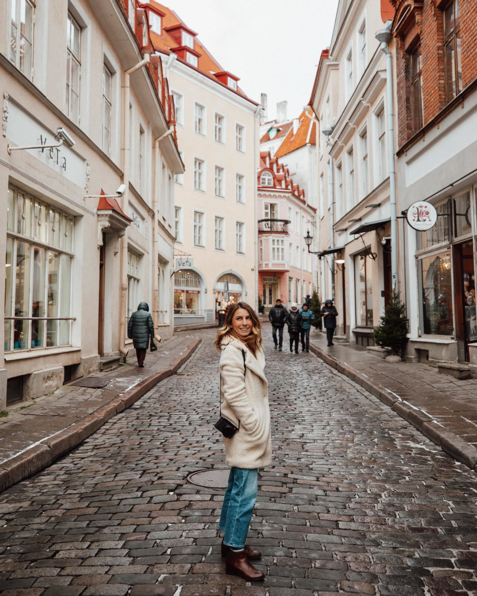 Tallinn Estonia during Christmas Markets in Winter | Our Baltic road trip itinerary includes Christmas market ideas for some lesser known European cities that shouldn't be missed. Click through to find out where we stayed, ate and explored in Estonia, Latvia and Lithuania! #christmasmarkets #europetravel #wintertravel #christmastraditions #riga #tallin #vilnius #estonia #lithuania #finduslost