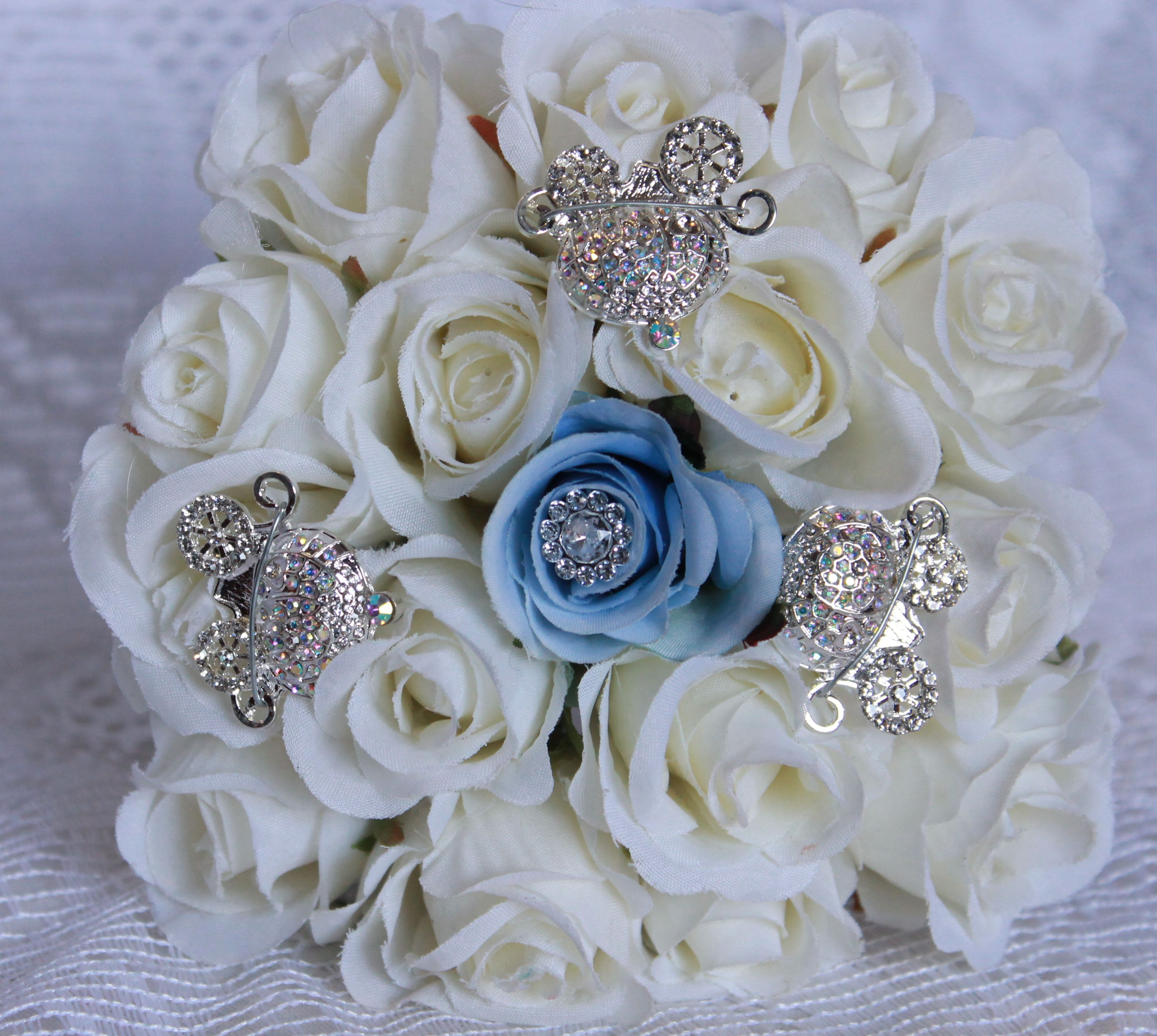 Silk Flowers And Rhinestone Brooches For This Toss Bouquet In A