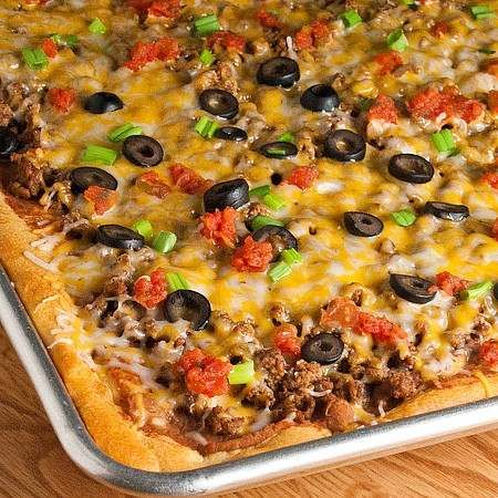 Taco pizza    1 lb. ground beef  1 envelope taco seasoning mix  2 (8 oz.) cans pillsbury crescent rolls  1 (16 oz.) can refried beans (i used the jalape�o kind)  2-3 cups shredded cheddar cheese or mexican blend  1/2 cup chopped tomatoes  1/4 cup sliced black olives  4 green onions, chopped