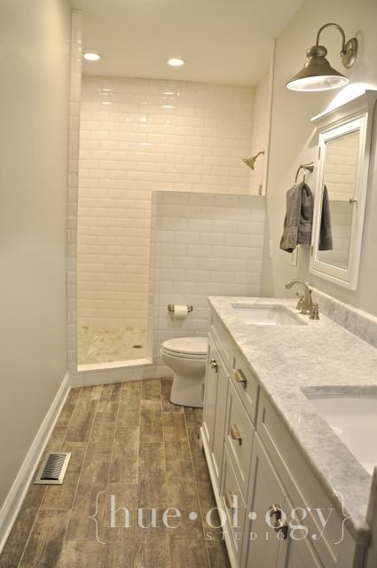Metro Wall Tiles, Interlocking Vinyl Wood Flooring And Carrara Marble  Vanity Surface, All Available