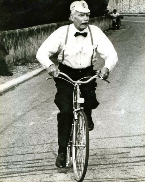Laurence Olivier rides a bike