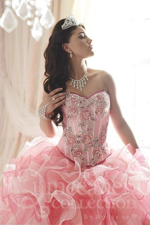 6968a2e45 An enamoring ball gown made with glimmering bead appliqués on its classy  corset bodice. The