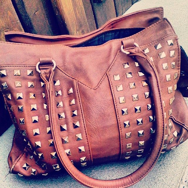Studded brown leather bag