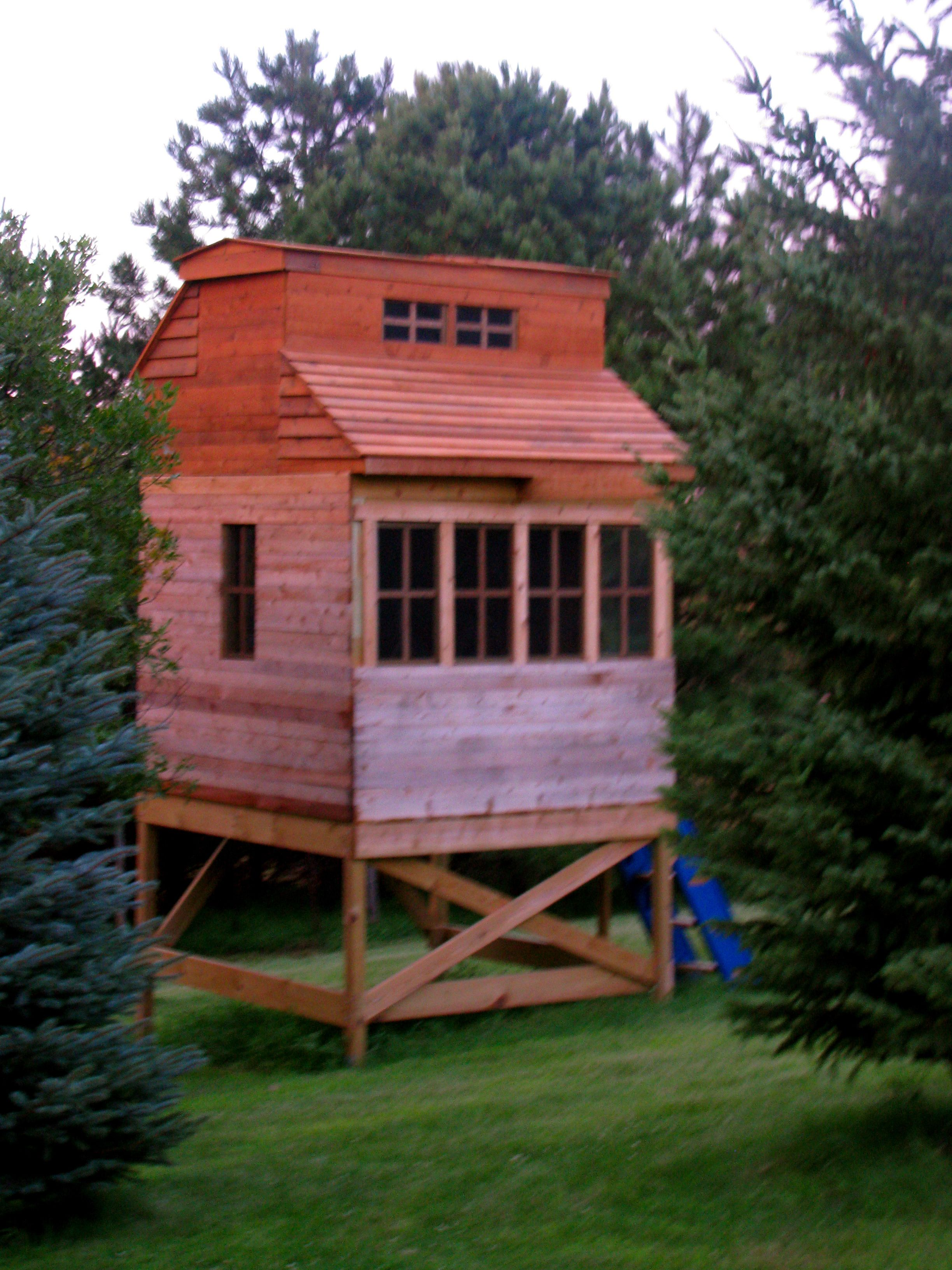 my husband built this 2 story fort with a retractable roof for our