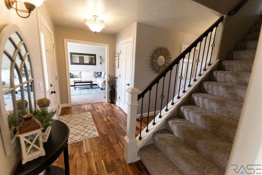 love the white trim, hardwood floors, stairs (With images