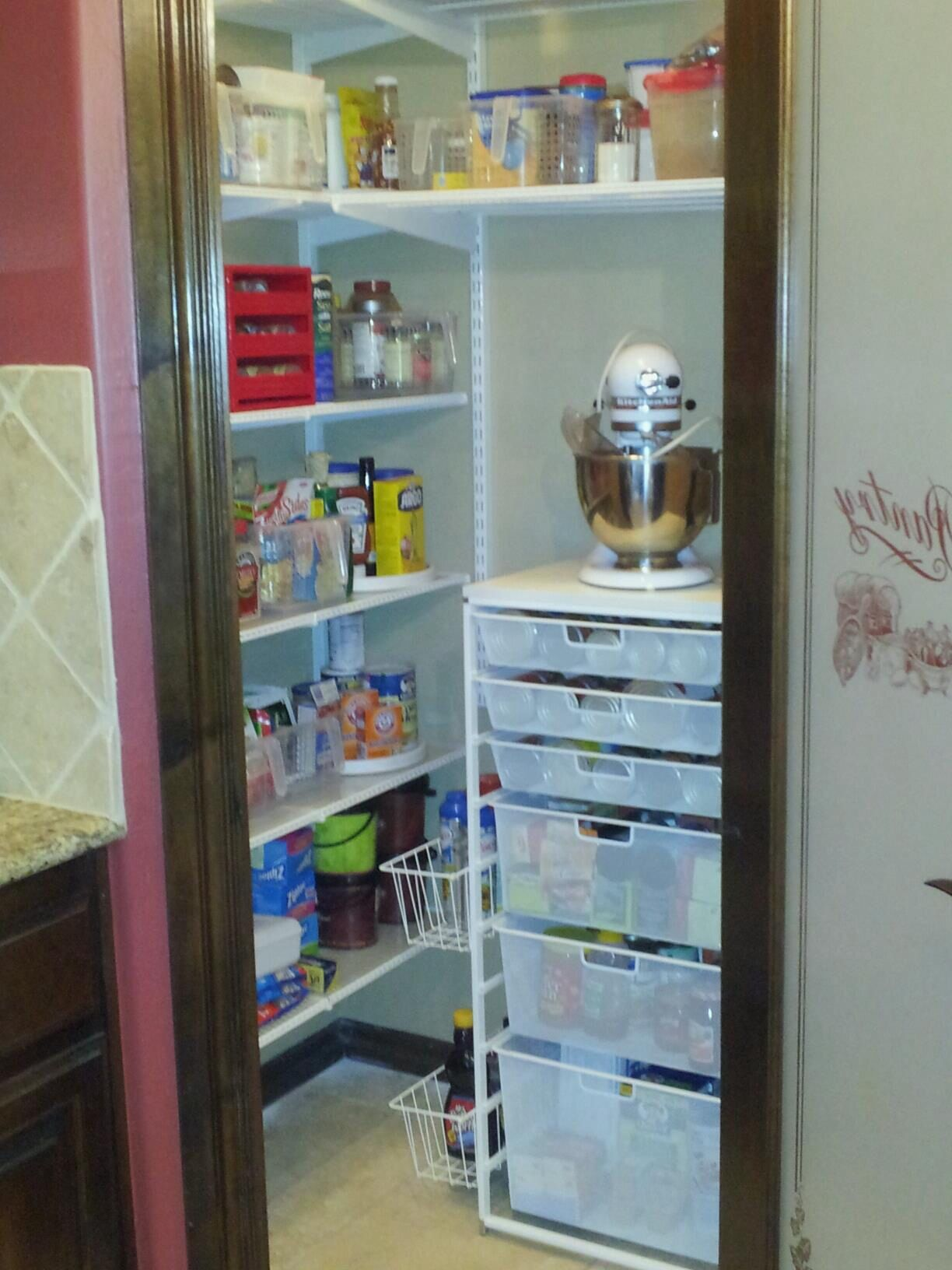 Organized Elfa pantry from my previous house. Upper shelving held ...