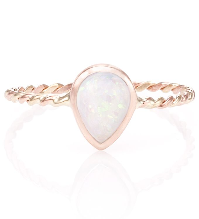 Opal Twist Ring A pear shaped Opal cabochon is set in a simple and