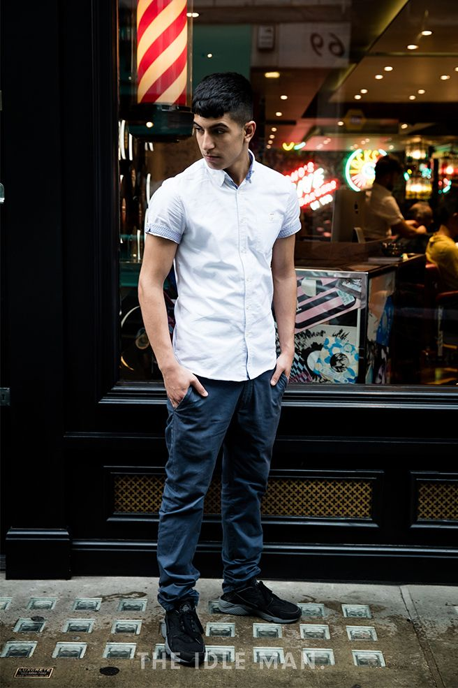 Men's street style | Blues - With there being so many shades of Blue, its easy to pair. Try a light blue short sleeved shirt and a navy blue pair of chinos. Black or navy trainers will always work with combo. | Shop the look at The Idle Man
