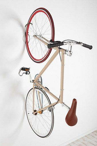 Save floor space by mounting your bike to the wall!  UrbanOutfitters.com > Bike Tire Tray and Wall Hook