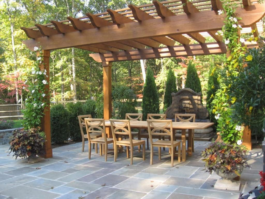 Wooden Exterior Dining Place With Green Vertical Garden Pergola ...