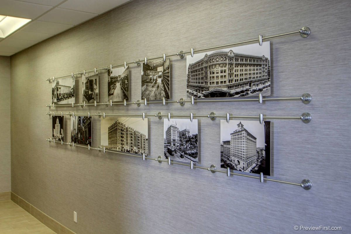 Custom art display shows 100 years of companies history for Wall art ideas for office