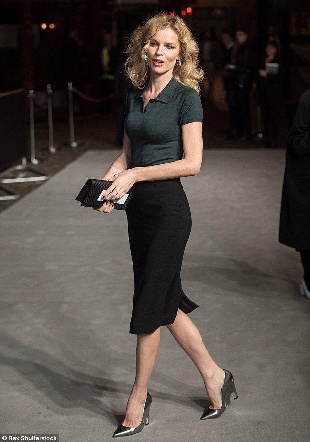 Running in heels: The blonde wore metallic heels with a quirky wedge heel...