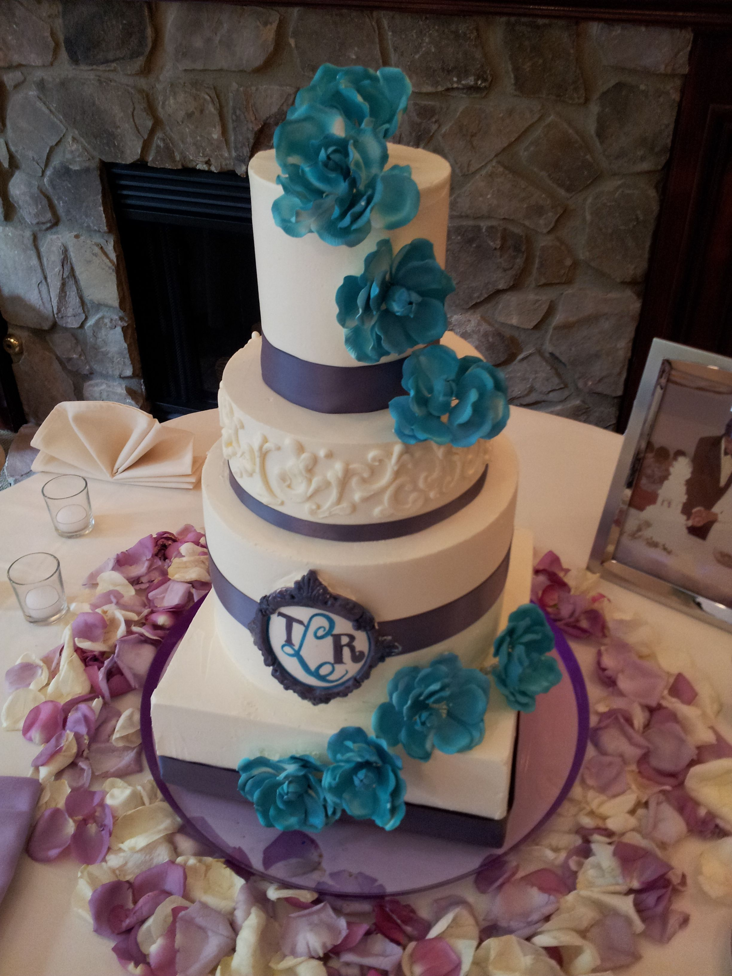 wedding cakes turquoise and purple purple and turquoise buttercream wedding cake with satin 25793