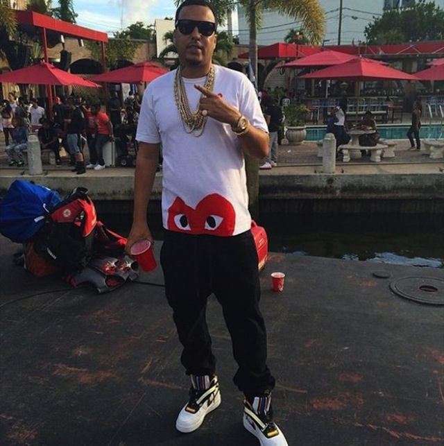 French Montana wears Comme des Garcons Play Tee and Nike Air Force One High RT Sneakers