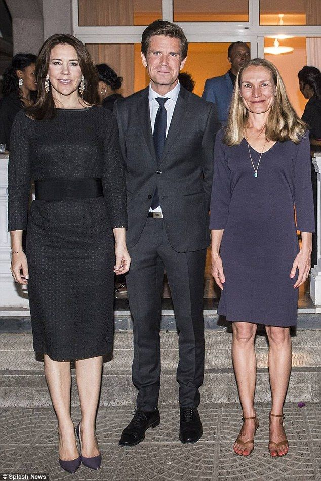 Simple yet stylish: Princess Mary wore a beautiful black frock for her evening with the am...