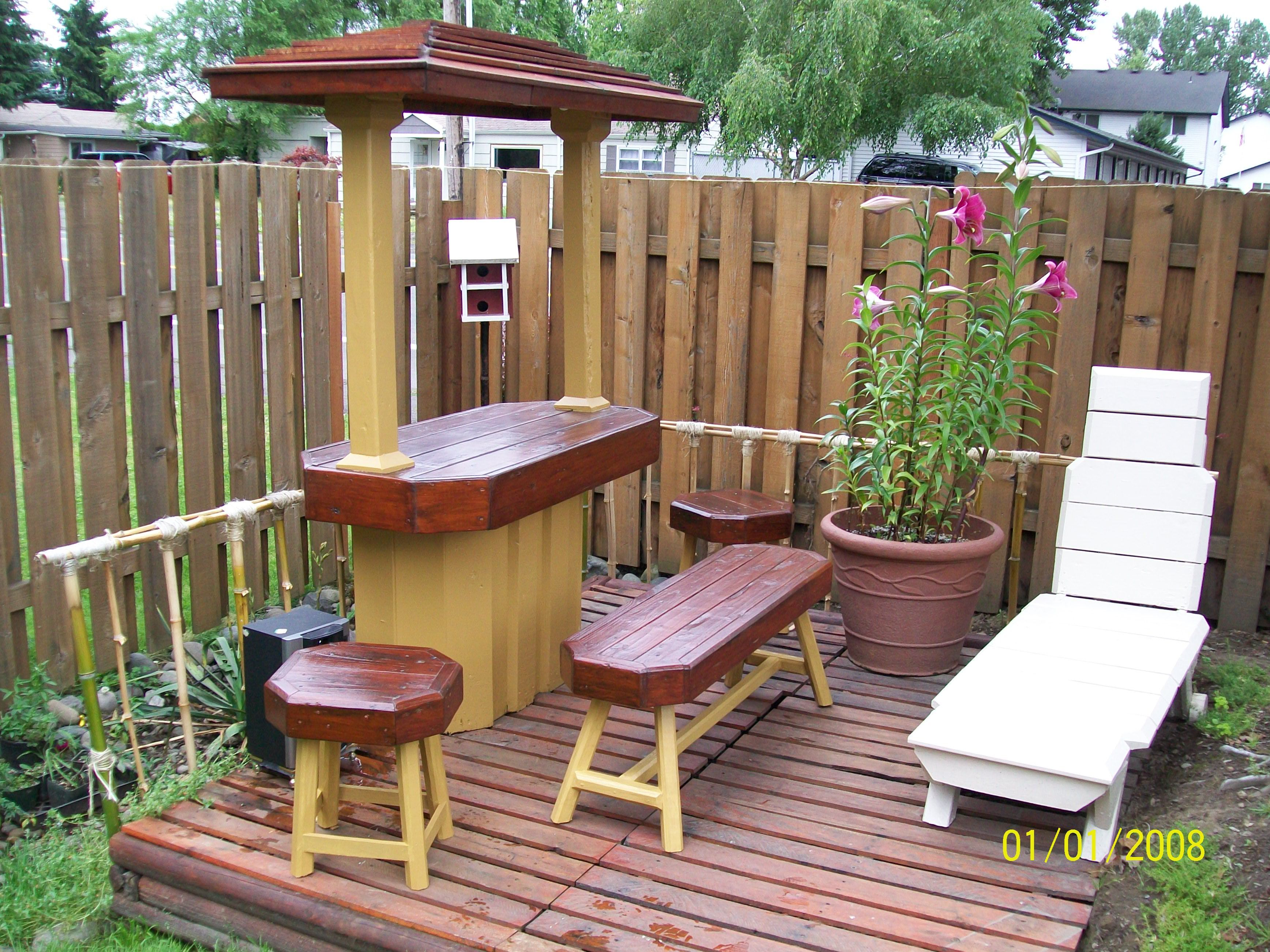 Large pallet bar with pallet stools and bench with pallet deck